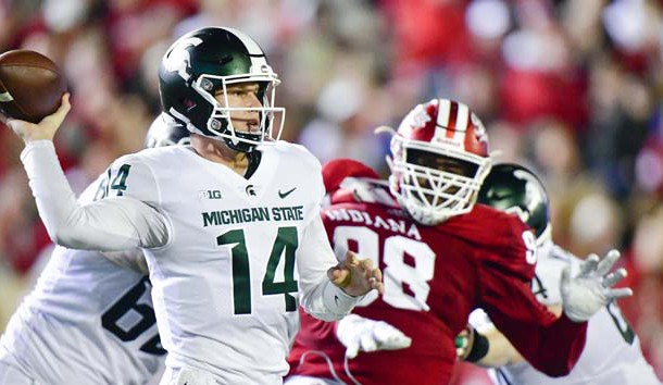 Sep 22, 2018; Bloomington, IN, USA; Michigan State Spartans quarterback Brian Lewerke (14) attempts a pass under pressure from Indiana Hoosiers defensive lineman Jerome Johnson (98) during the first half at Memorial Stadium. Photo Credit: Marc Lebryk-USA TODAY Sports