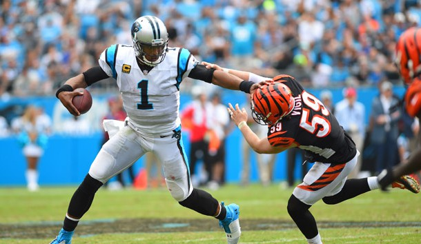 Sep 23, 2018; Charlotte, NC, USA; Carolina Panthers quarterback Cam Newton (1) with the ball as Cincinnati Bengals linebacker Nick Vigil (59) defends in the fourth quarter at Bank of America Stadium. Photo Credit: Bob Donnan-USA TODAY Sports