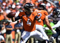 Keenum overcomes interceptions in Broncos debut