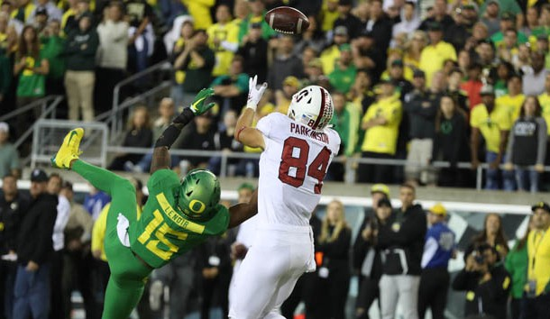 Sep 22, 2018; Eugene, OR, USA;  Stanford Cardinal tight end Colby Parkinson (84) tips the ball to himself for a touchdown over Oregon Ducks cornerback Deommodore Lenoir (15) in overtime at Autzen Stadium. Photo Credit: Jaime Valdez-USA TODAY Sports