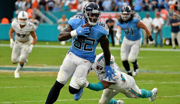 Sep 9, 2018; Miami Gardens, FL, USA; Tennessee Titans tight end Delanie Walker (82) avoids the tackle of Miami Dolphins cornerback Bobby McCain (28) during the second half at Hard Rock Stadium. Photo Credit: Jasen Vinlove-USA TODAY Sports