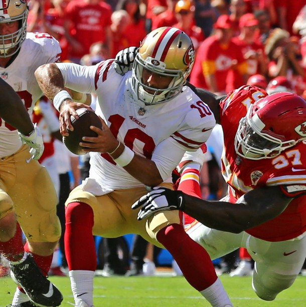 Sep 23, 2018; Kansas City, MO, USA; San Francisco 49ers quarterback Jimmy Garoppolo (10) is tackled by Kansas City Chiefs defensive end Allen Bailey (97) in the second half at Arrowhead Stadium. Photo Credit: Jay Biggerstaff-USA TODAY Sports