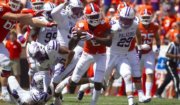 Sep 1, 2018; Clemson, SC, USA; Clemson Tigers wide receiver Justyn Ross (8) carries the ball for a touchdown while being defended by Furman Paladins linebacker Jordan Willis (30) and safety DiMarcus Clay (20) during the third quarter at Clemson Memorial Stadium. Photo Credit: Joshua S. Kelly-USA TODAY Sports