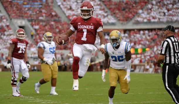 Sep 8, 2018; Norman, OK, USA; Oklahoma Sooners quarterback Kyler Murray (1) runs for a touchdown against the UCLA Bruins during the second quarter at Gaylord Family - Oklahoma Memorial Stadium. Mandatory Credit: Mark D. Smith-USA TODAY Sports