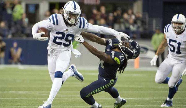 Oct 1, 2017; Seattle, WA, USA; Indianapolis Colts free safety Malik Hooker (29) stiff arms Seattle Seahawks cornerback DeAndre Elliott (21) as he runs back an interception during the second half at CenturyLink Field. The Seahawks won 46-18. Photo Credit: Troy Wayrynen-USA TODAY Sports