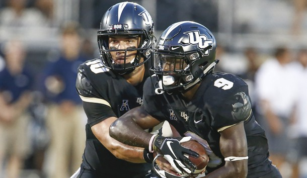 Sep 21, 2018; Orlando, FL, USA; UCF Knights quarterback McKenzie Milton (10) hands off to running back Adrian Killins Jr. (9) during the first quarter against the Florida Atlantic Owls at Spectrum Stadium. Photo Credit: Reinhold Matay-USA TODAY Sports