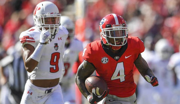 Sep 1, 2018; Athens, GA, USA; Georgia Bulldogs wide receiver Mecole Hardman (4) runs past Austin Peay Governors defensive back Trent Taylor (9) for a touchdown during the first half at Sanford Stadium. Photo Credit: Dale Zanine-USA TODAY Sports