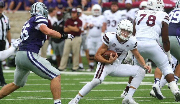 Sep 8, 2018; Manhattan, KS, USA; Mississippi State Bulldogs quarterback Nick Fitzgerald (7) carries the ball against Kansas State Wildcats defensive end Wyatt Hubert (56) during the fourth quarter at Bill Snyder Family Stadium. The Bulldogs won 31-10. Photo Credit: Scott Sewell-USA TODAY Sports