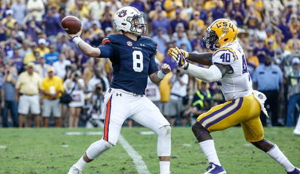 Auburn Tigers quarterback Jarrett Stidham (8) is hit by LSU Tigers linebacker Devin White (40) as he throws during the second half of a game at Tiger Stadium. LSU defeated Auburn 27-23 last season in Baton Rouge.. Photo Credit: Derick E. Hingle-USA TODAY Sports