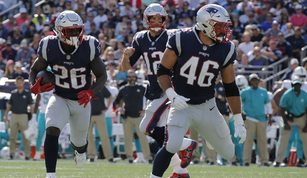 Sep 30, 2018; Foxborough, MA, USA; New England Patriots running back Sony Michel (26) runs the ball against the Miami Dolphins in the first half at Gillette Stadium. Photo Credit: David Butler II-USA TODAY Sports