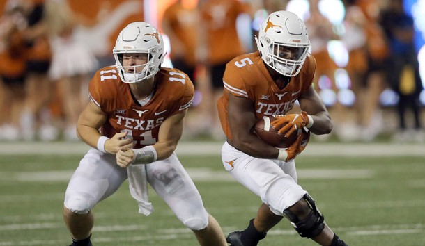 Sep 8, 2018; Austin, TX, USA; University of Texas Longhorns quarterback Sam Ehlinger (11) hands the ball to running back Tre Watson (5) in the 1st half against University of Tulsa Golden Hurricane at Darrell K Royal-Texas Memorial Stadium. Photo Credit: Jamie Harms-USA TODAY Sports