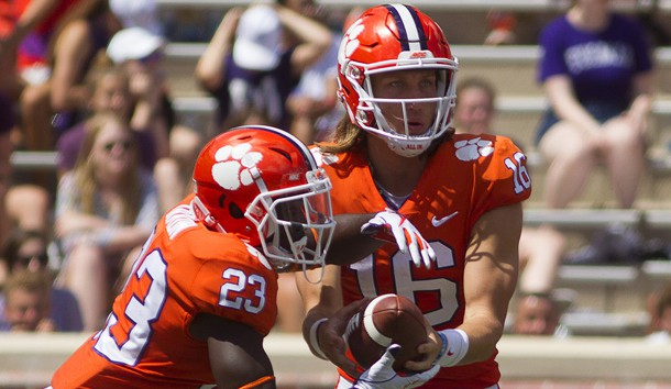 Sep 1, 2018; Clemson, SC, USA; Clemson Tigers quarterback Trevor Lawrence (16) hands the ball off to Clemson Tigers running back Lyn-J Dixon (23) during the third quarter at Clemson Memorial Stadium. Photo Credit: Joshua S. Kelly-USA TODAY Sports