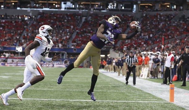 Sep 1, 2018; Atlanta, GA, USA; Washington Huskies wide receiver Quinten Pounds (21) makes a touchdown catch against Auburn Tigers defensive back Jamel Dean (12) in the second quarter at Mercedes-Benz Stadium. Photo Credit: Jason Getz-USA TODAY Sports