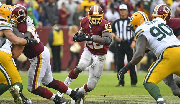 Sep 23, 2018; Landover, MD, USA; Washington Redskins running back Adrian Peterson (26) carries the ball against the Green Bay Packers during the second half at FedEx Field. Photo Credit: Brad Mills-USA TODAY Sports