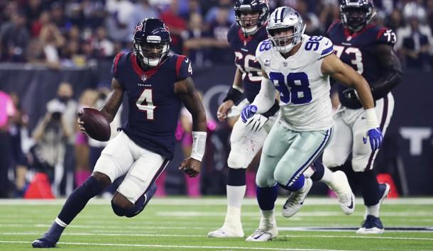 Oct 7, 2018; Houston, TX, USA; Houston Texans quarterback Deshaun Watson (4) runs past Dallas Cowboys defensive end Tyrone Crawford (98) during the first quarter at NRG Stadium. Photo Credit: Kevin Jairaj-USA TODAY Sports