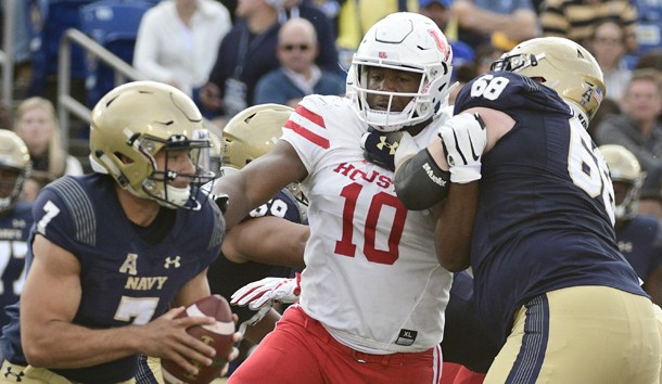 Oct 20, 2018; Annapolis, MD, USA; Houston Cougars defensive tackle Ed Oliver (10) applies pressure on Navy Midshipmen quarterback Garret Lewis (7)  as guard David Forney (68) blocks during the second quarter at Navy-Marine Corps Memorial Stadium. Photo Credit: Tommy Gilligan-USA TODAY Sports