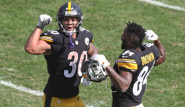 Oct 7, 2018; Pittsburgh, PA, USA;  Pittsburgh Steelers running back James Conner (30) celebrates his touchdown with wide receiver Antonio Brown (84) against the Atlanta Falcons during the third quarter at Heinz Field. The Steelers won 41-17. Photo Credit: Charles LeClaire-USA TODAY Sports