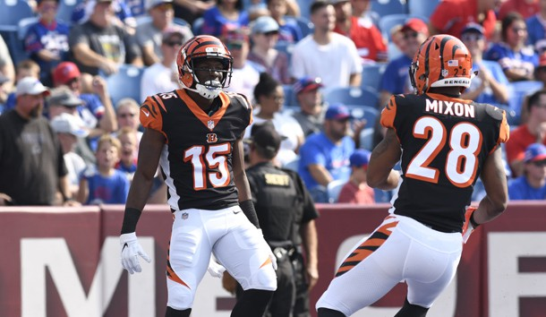 Aug 26, 2018; Orchard Park, NY, USA; Cincinnati Bengals wide receiver John Ross (15) celebrates scoring a touchdown as running back Joe Mixon (28) joins in during the first quarter of a game against the Buffalo Bills at New Era Field. Photo Credit: Mark Konezny-USA TODAY Sports