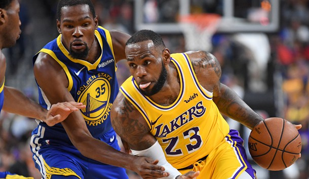 Oct 10, 2018; Las Vegas, NV, USA; Los Angeles Lakers forward LeBron James (23) dribbles against the defense of Golden State Warriors forward Kevin Durant (35) during the first half at T-Mobile Arena. Photo Credit: Stephen R. Sylvanie-USA TODAY Sports