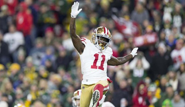 Oct 15, 2018; Green Bay, WI, USA; San Francisco 49ers wide receiver Marquise Goodwin (11) celebrates after scoring a touchdown by performing a long jump during the second quarter against the Green Bay Packers at Lambeau Field. Photo Credit: Jeff Hanisch-USA TODAY Sports