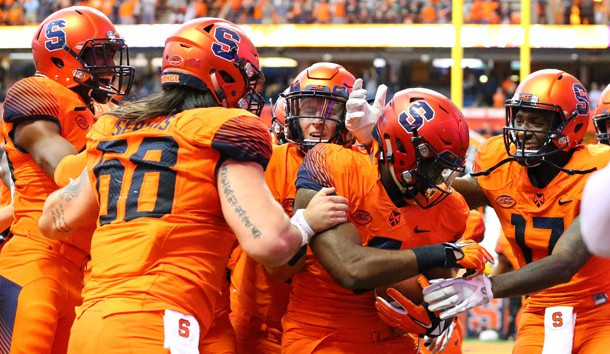 Oct 20, 2018; Syracuse, NY, USA; Syracuse Orange tight end Ravian Pierce (center) celebrates his game winning touchdown catch with teammates in overtime against the North Carolina Tar Heels at the Carrier Dome. Photo Credit: Rich Barnes-USA TODAY Sports