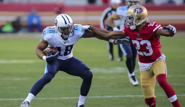Dec 17, 2017; Santa Clara, CA, USA; Tennessee Titans wide receiver Rishard Matthews (18) runs with the ball against San Francisco 49ers cornerback Ahkello Witherspoon (23) during the third quarter at Levi's Stadium. Photo Credit: Sergio Estrada-USA TODAY Sports