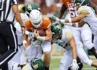 Texas' Ehlinger leaves with shoulder injury