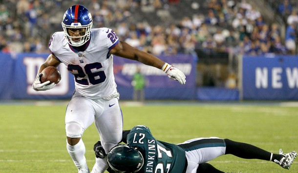Oct 11, 2018; East Rutherford, NJ, USA; New York Giants running back Saquon Barkley (26) runs the ball against Philadelphia Eagles safety Malcolm Jenkins (27) during the fourth quarter at MetLife Stadium. Photo Credit: Brad Penner-USA TODAY Sports