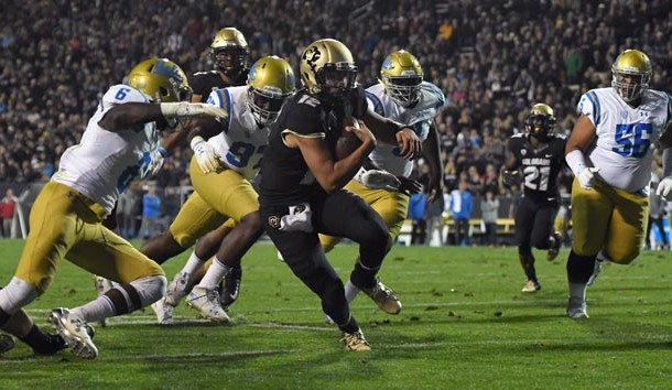 Sep 28, 2018; Boulder, CO, USA; Colorado Buffaloes quarterback Steven Montez (12) carries for a touchdown in the first half at Folsom Field. Photo Credit: Ron Chenoy-USA TODAY Sports