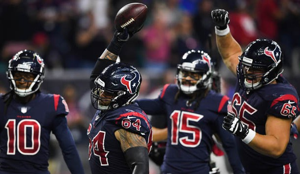 Oct 25, 2018; Houston, TX, USA; Houston Texans offensive guard Senio Kelemete (64) spikes the ball after a touchdown by wide receiver DeAndre Hopkins (10) during the fourth quarter against the Miami Dolphins at NRG Stadium. Photo Credit: Shanna Lockwood-USA TODAY Sports