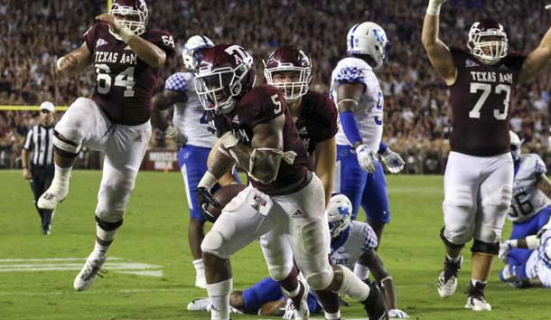 Oct 6, 2018; College Station, TX, USA; Texas A&M Aggies running back Trayveon Williams (5) celebrates after scoring on a game winning touchdown in overtime against the Kentucky Wildcats at Kyle Field. Photo Credit: John Glaser-USA TODAY Sports
