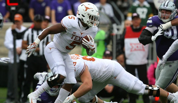 Sep 29, 2018; Manhattan, KS, USA; Texas Longhorns running back Tre Watson (5) looks for room to run during the first quarter against the Kansas State Wildcats at Bill Snyder Family Stadium. Photo Credit: Scott Sewell-USA TODAY Sports