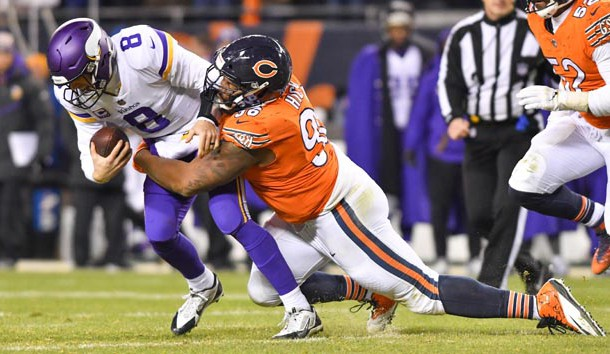 Nov 18, 2018; Chicago, IL, USA; Minnesota Vikings quarterback Kirk Cousins (8) is sacked by Chicago Bears defensive tackle Aklem Hicks (96) in the fourth quarter at Soldier Field. Photo Credit: Matt Cashore-USA TODAY Sports