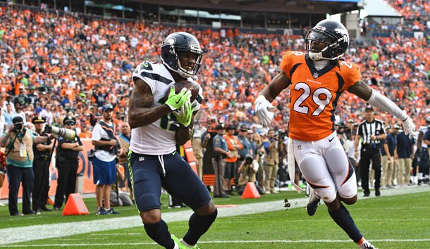Sep 9, 2018; Denver, CO, USA; Seattle Seahawks wide receiver Brandon Marshall (15) pulls in a touchdown in front of Denver Broncos cornerback Bradley Roby (29) in the fourth quarter at Broncos Stadium at Mile High. Photo Credit: Ron Chenoy-USA TODAY Sports