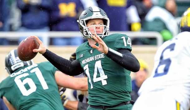 Oct 20, 2018; East Lansing, MI, USA; Michigan State Spartans quarterback Brian Lewerke (14) attempts to throw the ball during the second half of a game against the Michigan Wolverines at Spartan Stadium. Photo Credit: Mike Carter-USA TODAY Sports