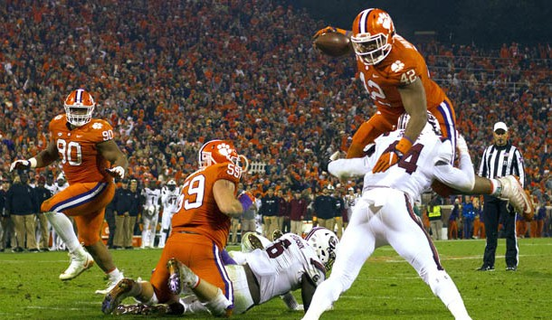 Nov 24, 2018; Clemson, SC, USA; Clemson Tigers defensive lineman Christian Wilkins (42) hurtles South Carolina Gamecocks linebacker Sherrod Greene (44) during the second quarter of the game to score a touchdown at Clemson Memorial Stadium. Photo Credit: Joshua S. Kelly-USA TODAY Sports