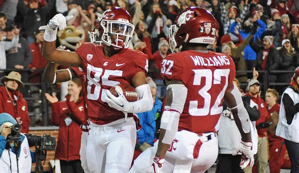 Nov 17, 2018; Pullman, WA, USA; Washington State Cougars wide receiver Calvin Jackson Jr. (85) celebrates a touchdown with teammate Washington State Cougars running back James Williams (32) during a game against the Arizona Wildcats in the first half at Martin Stadium. Photo Credit: James Snook-USA TODAY Sports