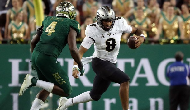 Nov 23, 2018; Tampa, FL, USA;UCF Knights quarterback Darriel Mack Jr. (8) runs with the ball as South Florida Bulls linebacker Greg Reaves (4) pressures during the second half at Raymond James Stadium. Photo Credit: Kim Klement-USA TODAY Sports