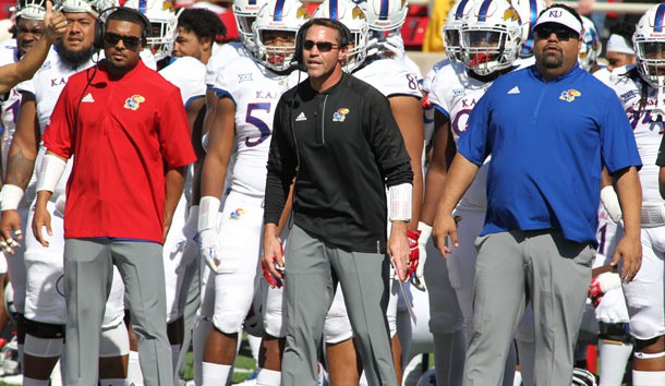 Oct 20, 2018; Lubbock, TX, USA; Kansas Jayhawks head coach David Beaty (center) looks on from the sidelines during the game against the Texas Tech Red Raiders at Jones AT&T Stadium. Photo Credit: Michael C. Johnson-USA TODAY Sports