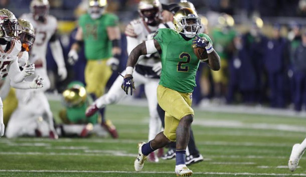 Nov 10, 2018; South Bend, IN, USA; Notre Dame Fighting Irish running back Dexter Williams (2) scores a touchdown on a 32 yard run against the Florida State Seminoles during the fourth quarter at Notre Dame Stadium. Photo Credit: Brian Spurlock-USA TODAY Sports
