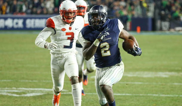 Nov 17, 2018; New York, NY, USA; Notre Dame Fighting Irish running back Dexter Williams (2) runs with the ball past Syracuse Orange defensive back Christopher Fredrick (3) during the fourth quarter at Yankee Stadium. Photo Credit: Rich Barnes-USA TODAY Sports