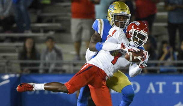 Sep 15, 2018; Pasadena, CA, USA; Fresno State Bulldogs wide receiver Jamire Jordan (1) makes a leaping catch on front of UCLA Bruins defensive back Darnay Holmes (1) in the third quarter at Rose Bowl. Photo Credit: Robert Hanashiro-USA TODAY Sports