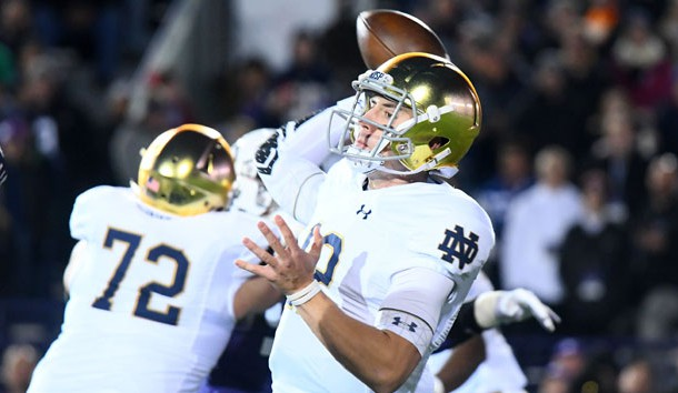 Nov 3, 2018; Evanston, IL, USA; Notre Dame Fighting Irish quarterback Ian Book (12) drop back top pass against the Northwestern Wildcats during the first quarter at Ryan Field. Photo Credit: Mike DiNovo-USA TODAY Sports