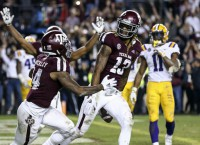Rogers' two-point conversion catch wins it for Aggies
