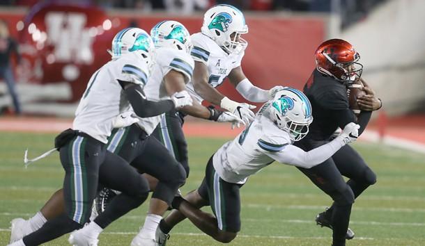 Nov 15, 2018; Houston, TX, USA; Houston Cougars quarterback D'Eriq King (4) is tackled by Tulane Green Wave linebacker Marvin Moody (28) in the second quarter at TDECU Stadium. Photo Credit: Thomas B. Shea-USA TODAY Sports