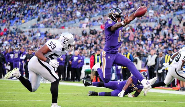 Nov 25, 2018; Baltimore, MD, USA; Baltimore Ravens quarterback Lamar Jackson (8) runs for a touchdown in the third quarter against the Oakland Raiders at M&T Bank Stadium. Photo Credit: Evan Habeeb-USA TODAY Sports