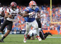 Gators use ground game to rally past Gamecocks