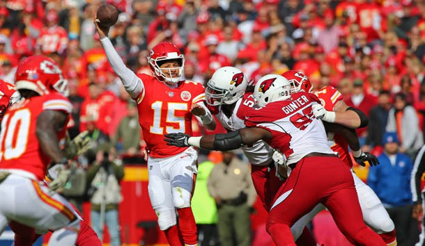 Nov 11, 2018; Kansas City, MO, USA; Kansas City Chiefs quarterback Patrick Mahomes (15) throws a pass as Arizona Cardinals linebacker Josh Bynes (57) and defensive tackle Rodney Gunter (95) defend in the first half at Arrowhead Stadium. Photo Credit: Jay Biggerstaff-USA TODAY Sports