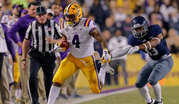Nov 17, 2018; Baton Rouge, LA, USA;  Rice Owls running back Collin Whitaker (13) pushes LSU Tigers running back Nick Brossette (4) out of bounds in the first quarter at Tiger Stadium.  Photo Credit: Stephen Lew-USA TODAY Sports