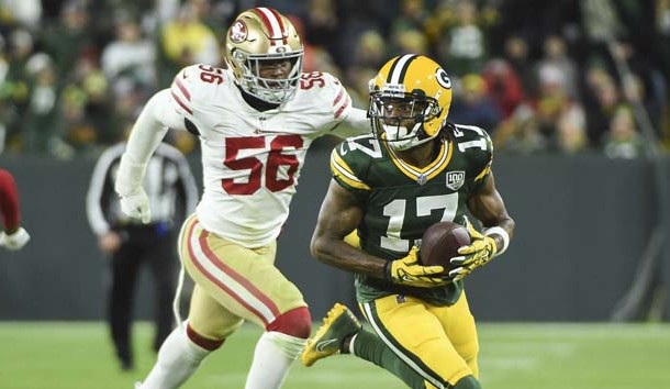 Oct 15, 2018; Green Bay, WI, USA; Green Bay Packers wide receiver Davante Adams (17) breaks away from San Francisco 49ers linebacker Reuben Foster (56) after making a catch in the fourth quarter at Lambeau Field. Photo Credit: Benny Sieu-USA TODAY Sports